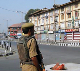 Major J&K towns under curfew, air services suspended
