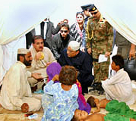 President visits relief camps, emergency hospital
