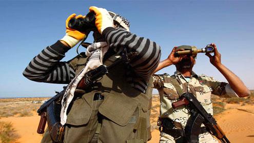 Rebels push west before Libya crisis talks