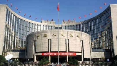 China central bank chief says tightening to continue