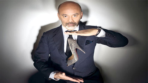 Red soles are his alone, French designer says