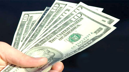 THE RUPEE: dollar moves both ways