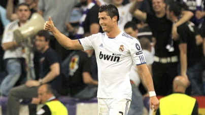 UEFA Champions League 2011: Adebayor leads Real to 4-0 rout of 10-man Spurs