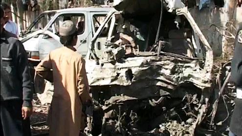 Car bombing kills 13 at Peshawar bus terminal