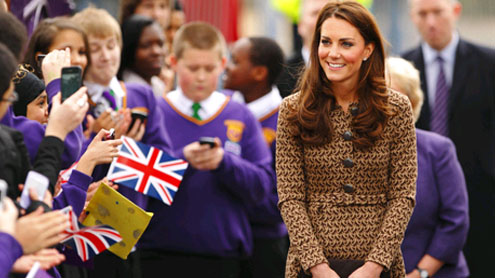 Duchess of Cambridge smudged in paint after school visit