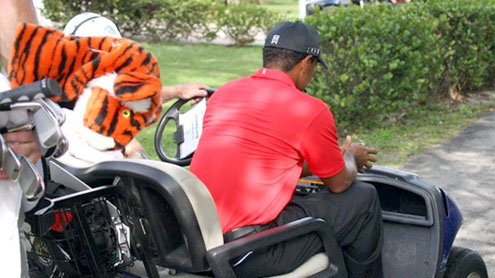Tiger Woods exits with left leg injury