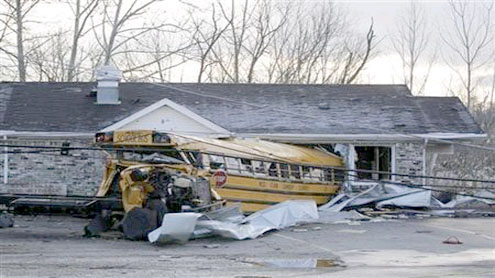 Tornado-ravaged areas hit by snowstorm, cold