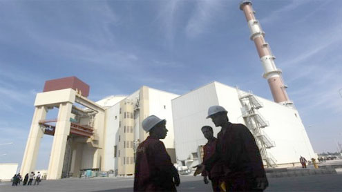 Iran wants sanctions eased, hints on enrichment