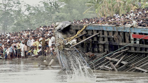 Overloaded Indian ferry capsizes killing 103, more missing