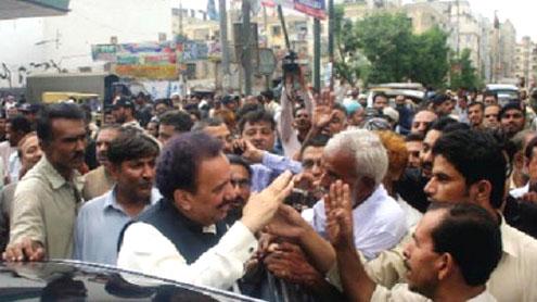 Malik seeks support for govt's peace efforts in Lyari