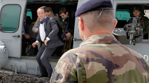France's Hollande defends early Afghan troop pullout