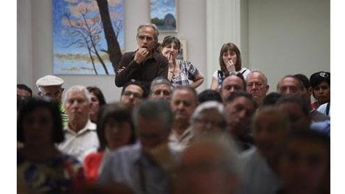 Spain beset by bank crisis, downgrades, bond pressure