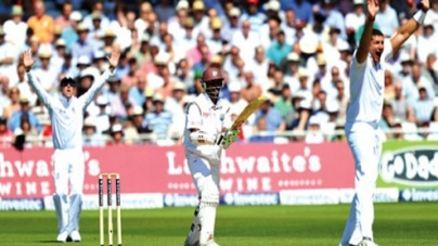 WI fight back against England
