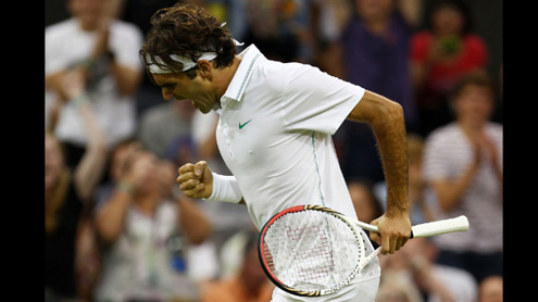 Fighting Federer pulls off 'brutal' escape at Wimbledon