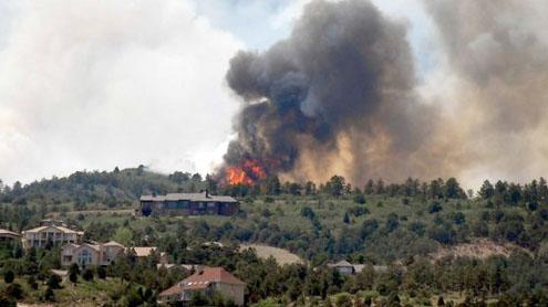 Vicious wildfires spread to Colo. tourist centers