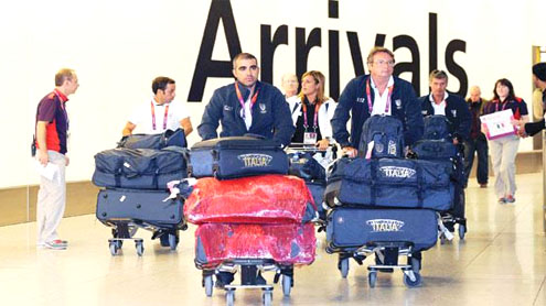 Athletes arrive in London, airport under pressure