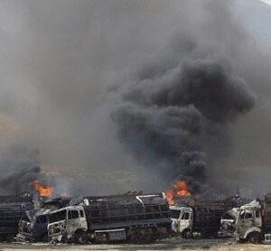Bomb destroys 22 Nato trucks