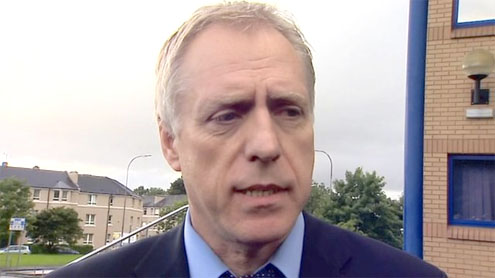 Former editor of Scottish News of the World arrested