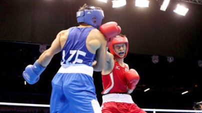 London 2012: more boos as boxer is knocked down five times but wins