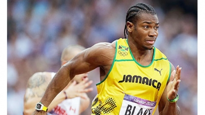 London 2012: Bolt and Blake progress through to Olympic 200m final