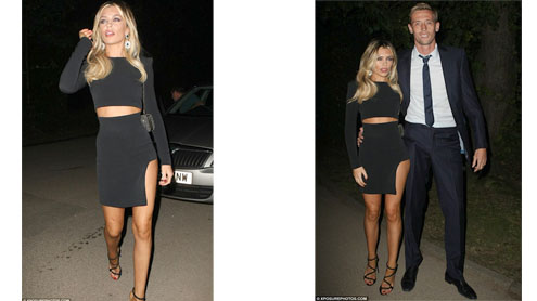 Abbey Crouch turns up the heat as she shows off her tanned legs in very short cutaway dress