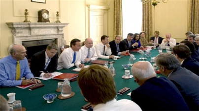 Cameron piles Cabinet with record 32 ministers