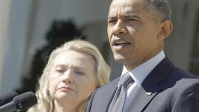 Obama vows justice after U.S. envoy killed in Libya