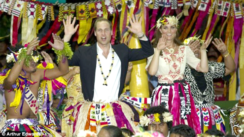 Swaying to the South Pacific beat: William and Kate don grass skirts as they join the tribal dance