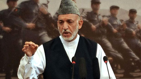 Afghan president warns on immunity for foreign troops