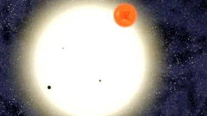 Astronomers discover planet with four suns