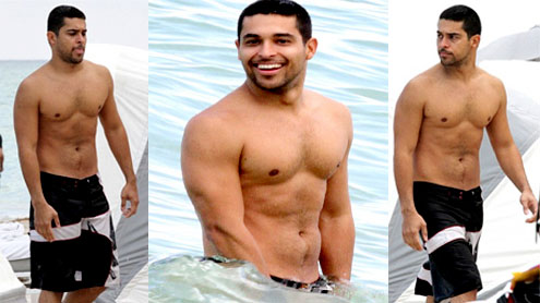 Shirtless Wilmer Valderrama takes a dip in the Miami surf