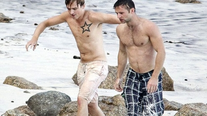 Tom Fletcher and Harry Judd show off their six packs in the sea