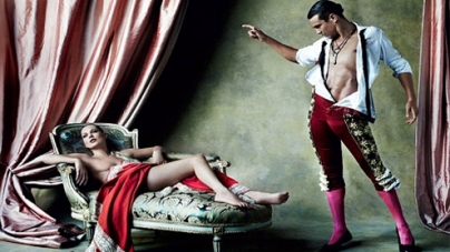Kate Moss wears just a cape to cover her nudity in a new Vogue photoshoot