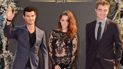 Kristen Stewart wears a revealing lace and sequin jumpsuit at Breaking Dawn premiere