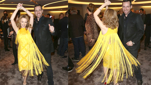 Kylie Minogue hits the dance floor in lemon yellow dress