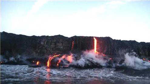 Lava flows from Hawaii into the ocean at night