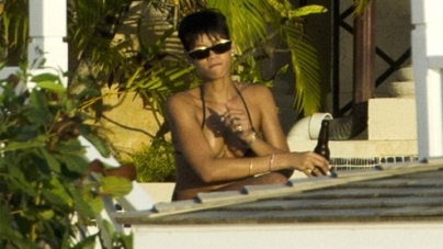 Bikini girl Rihanna enjoys the single life with her best friend as she takes a beach vacation in Barbados