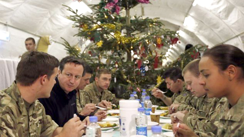 David Cameron joins troops in Afghanistan for a surprised pre-Christmas