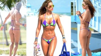 Fitness guru Jennifer Nicole Lee struts around in a TINY string bikini