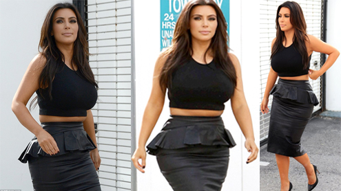 Kim Kardashian bursts over the waistline in a too-tight leather peplum skirt