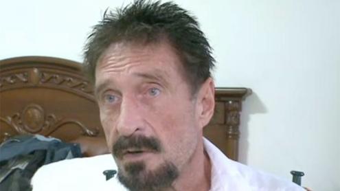 On the run, software guru McAfee says left Belize, won't surrender