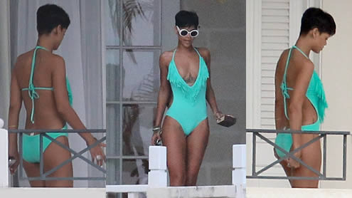 Rihanna Relaxes in a VERY low cut Monokini