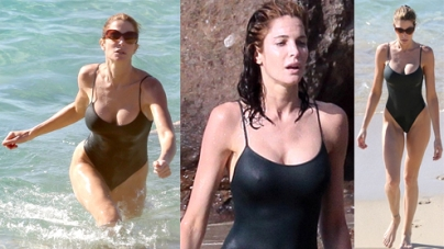 Stephanie Seymour showing perfect body in a high-cut black one-piece swimsuit