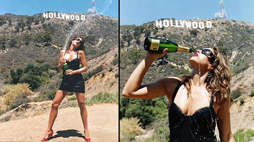 Cindy Crawford Welcomes New Year 2013 Under Hollywood Sign And Pops Champagne
