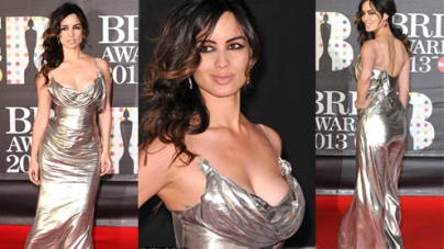 Bérénice Marlohe wears plunging sheer silver dress at Brit Awards