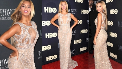 Beyonce displays cleavage in a daring sheer floorlength gown