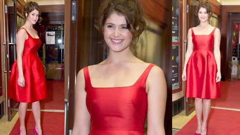 Gemma Arterton dazzles in a scarlet puffball dress