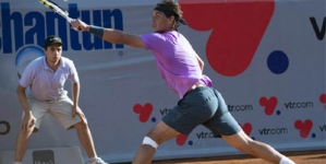 Nadal triumphs in singles return
