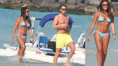 Tamara Ecclestone barely covers her curves in skimpy blue bikini on Dubai beach