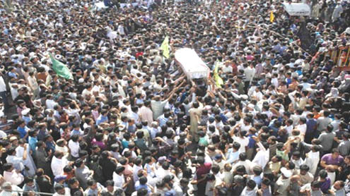 Karachi begins burials amid sobs, unrest